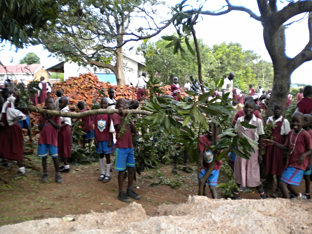 Students clear the area to make room for a girls dormitory being built
