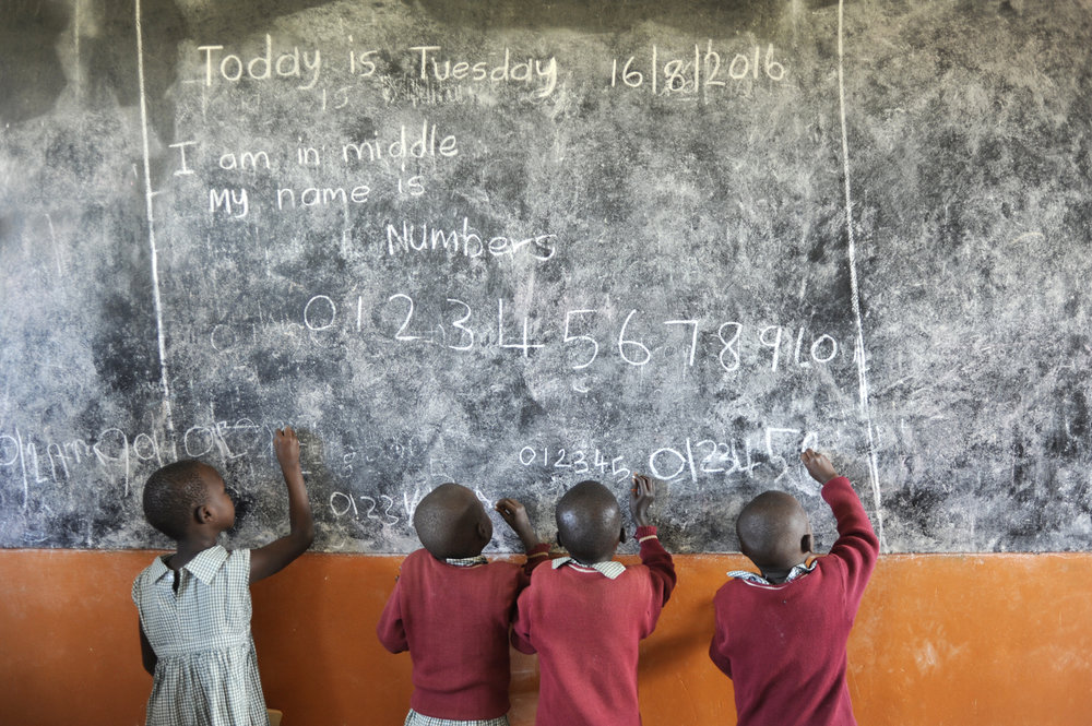 Young students at the chalkboard