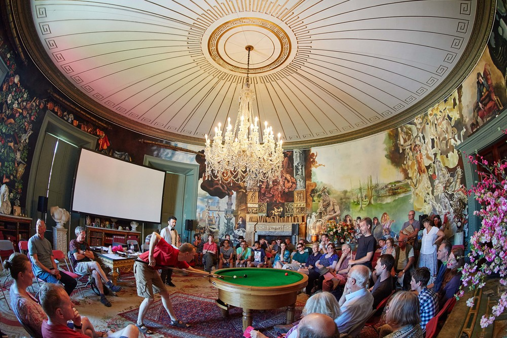 The tournament was held in the Round Room at Port Eliot, Cornwall, on July 31 and August 1, 2015. The room,  designed in 1804 by Sir John Soane,  is one of the architectural highlights of Port Eliot. British artist Robert Lenkiewicz spent 30 years on and off painting the mural and it is considered his masterpiece. With so much British architectural and artistic heritage in the room it seemed the perfect venue to make sporting history with the launch of LOOP. The pocket was positioned directly underneath the centre of the chandelier. Picture: Michael Bowles.