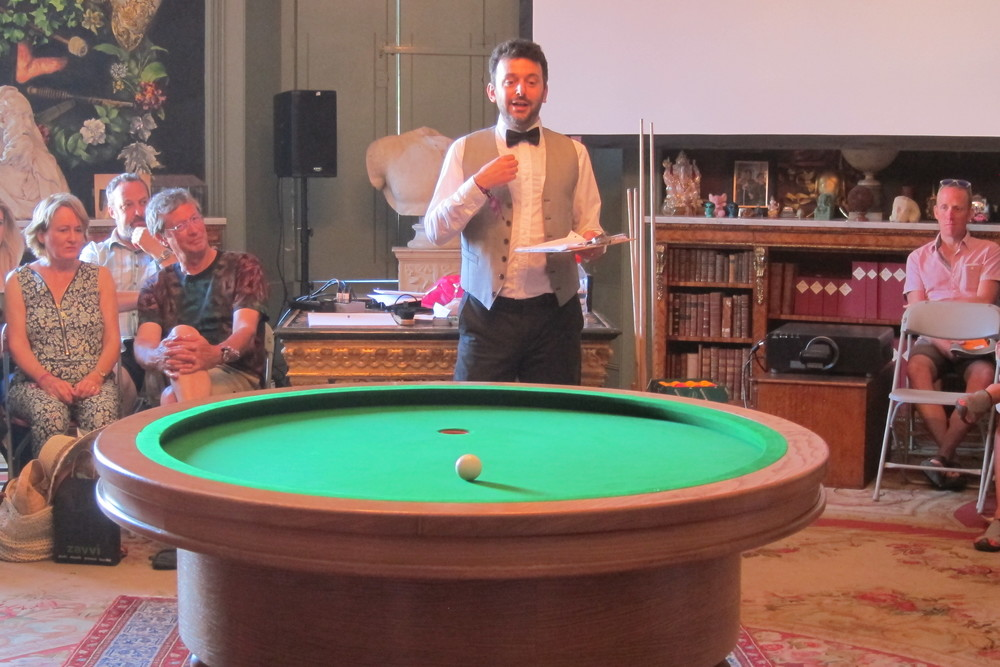 I introduced the table with a short explanation of the ellipse from Apollonius to today, demonstrating the unique geometry of LOOP and setting out the rules. Many in the audience were grateful that in addition to seeing the launch of a new sport they were given a maths lesson too.  Picture: Alex Bellos.