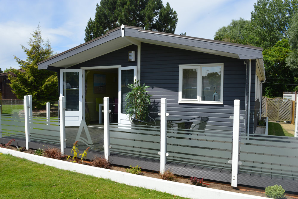 Above: Example of a UK Lodge at Tingdene Broadlands Park & Marina in Suffolk - 125 year lease, 3 bedrooms and a luxury decking with easy access to nearby Southwold.