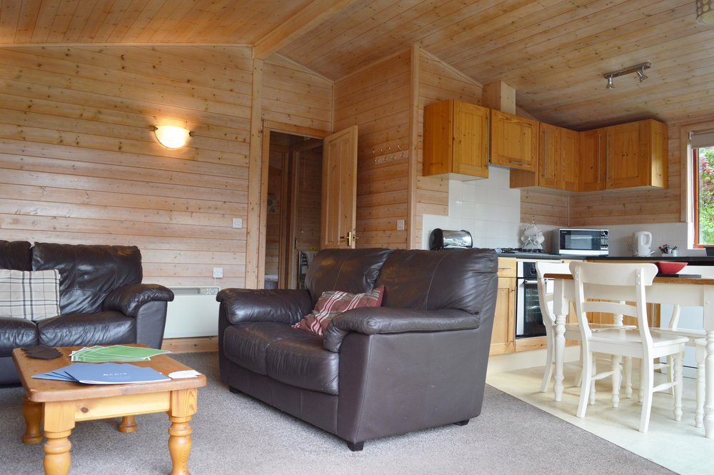 Above: Lodge interior - 2 bedrooms, open plan lounge/ kitchen, bathroom & soak up the outdoors with a brand new glass decking.