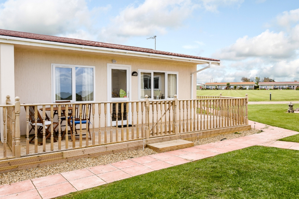 Images: Above & below - A 2 bedroom holiday cottage with a contemporary twist, 12 month holiday use, a long 99 year lease, timber decking, relaxing by the coast and you can even earn an income from holiday lettings when you are not using, sounds good doesn't it!