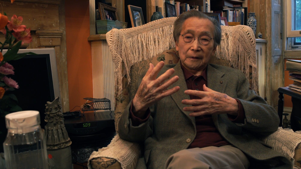 """Professor Chou of Columbia University, original member of the selection committee, selecting the Chinese qin song """"Flowing Waters"""" by Kuan P'ing-hu."""