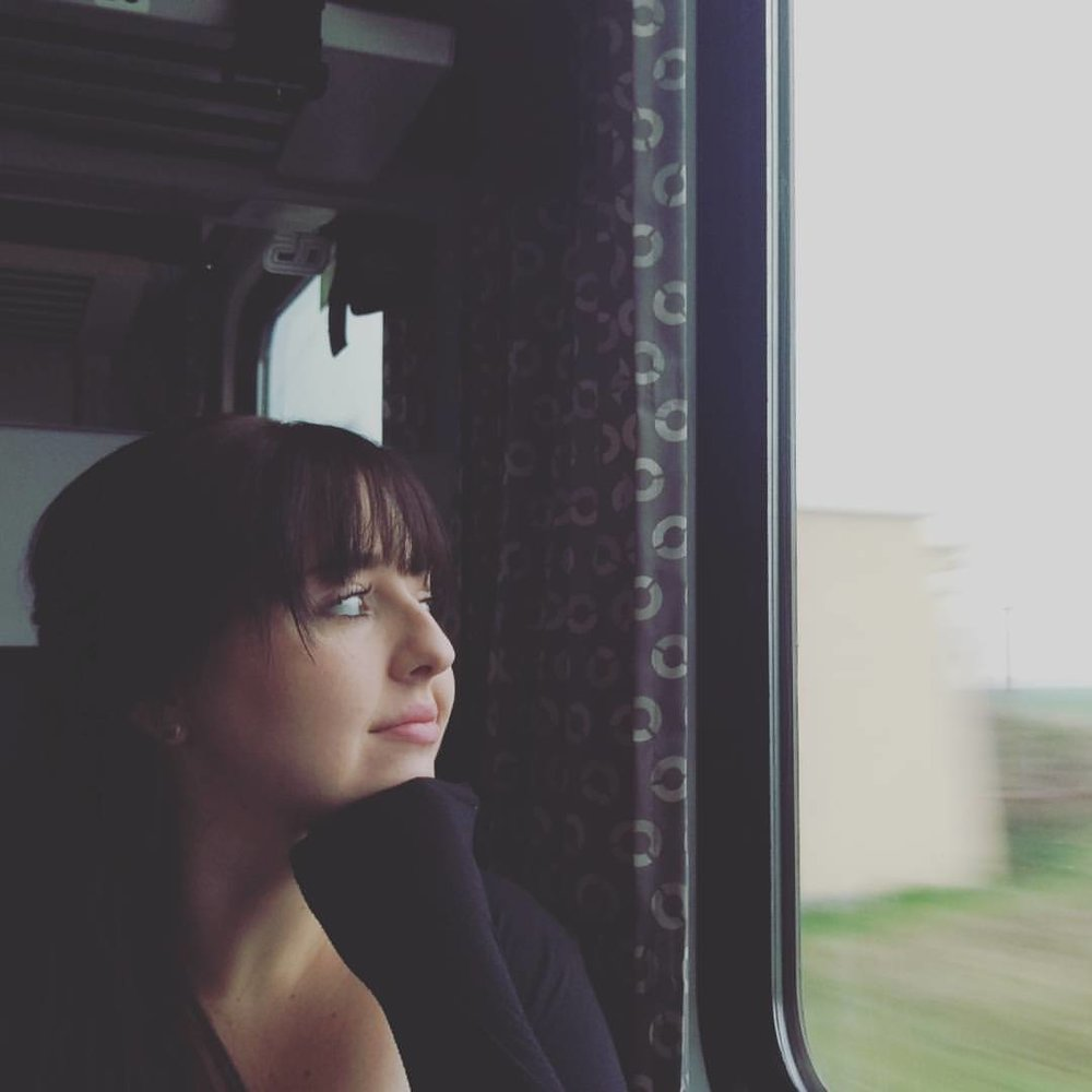 Ashley on a train to budapest, hungary.