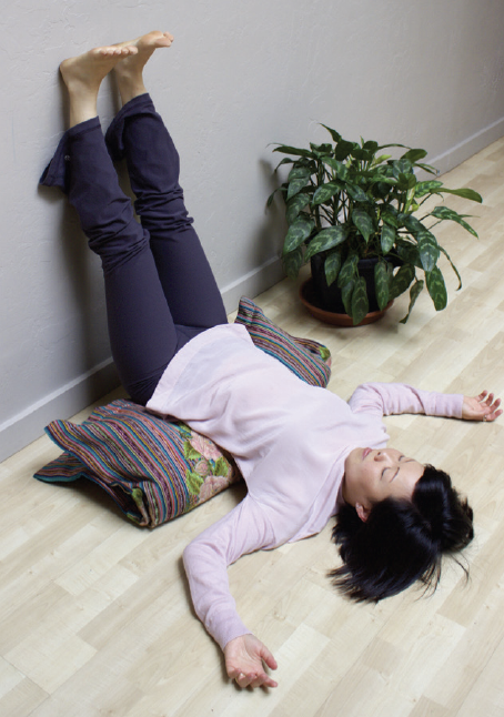 Viparita karani - legs up the wall.  Try this for 10 minutes.