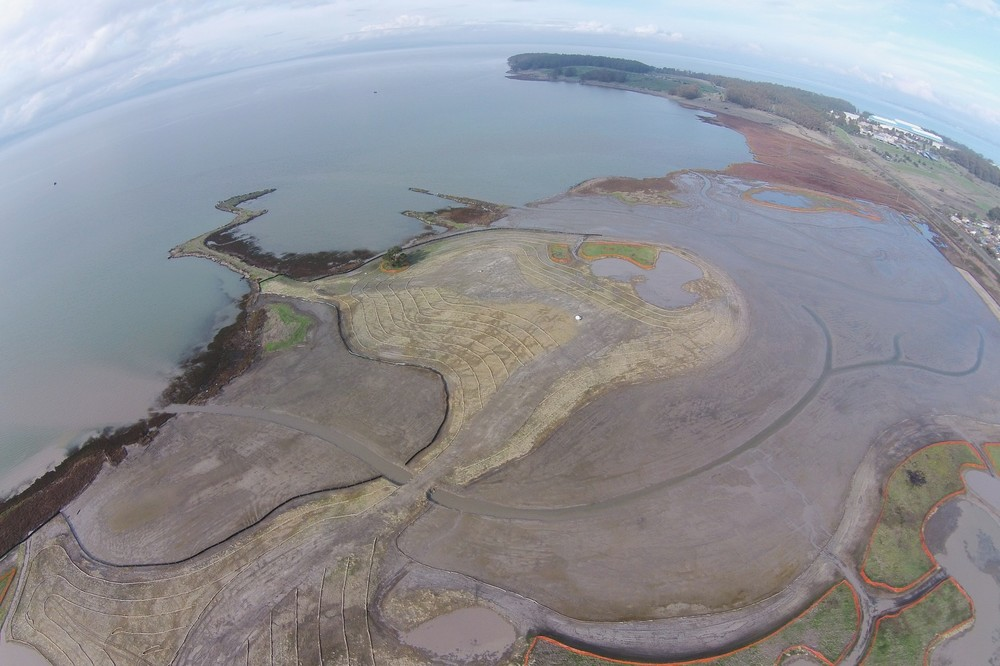 Breuner Marsh aerial view under a king tide in Dec. 2014 after completion of site grading. Photo credit East Bay Regional Park District.