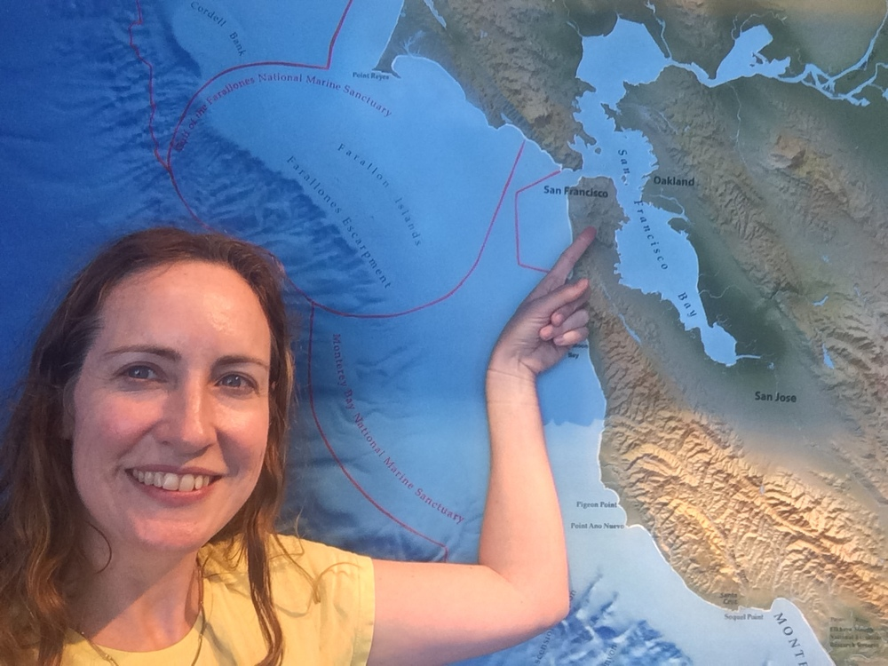 Posing with the huge map at the Monterey Bay National Marine Sanctuary Exploration Center in Santa Cruz, CA.