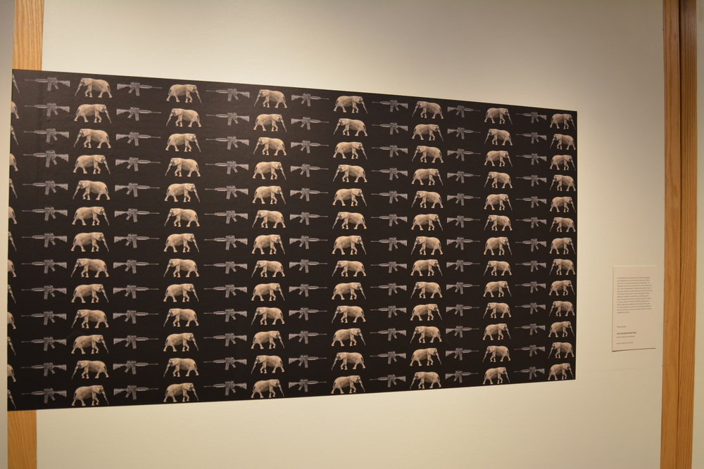 Traer Scott One Hundred and Four Photograph: Archival inkjet wall application, 45 in. wide An estimated one hundred and four African Elephants are slaughtered by ivory poachers every day in Africa. This piece is a visual representation of that data, a predictable pattern of death which combined with habitat loss, has lead the African Elephant population to a state of official vulnerability.