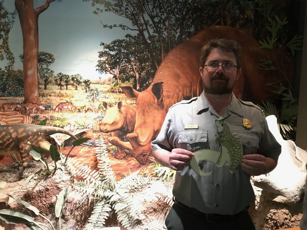 On this day, Christina, Jules, and Percival stopped in at a visitor center in Badlands National Park, South Dakota, and met paleontologist Ed Walsh, an expert on ancient pangolins!