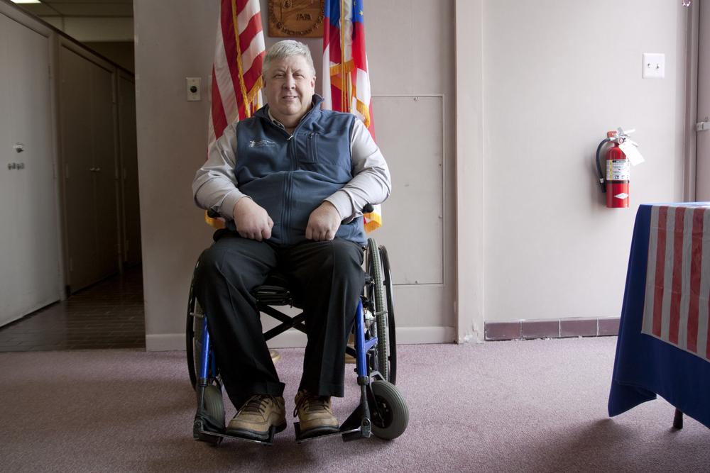 wheelchair_user_by_american_flag.jpg