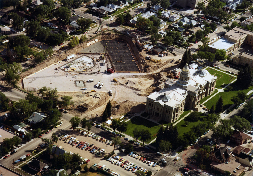 P99-63_416, Construction of Herschler Bldg, pouring concrete foundtation, aerial, 5-18-1981.jpg