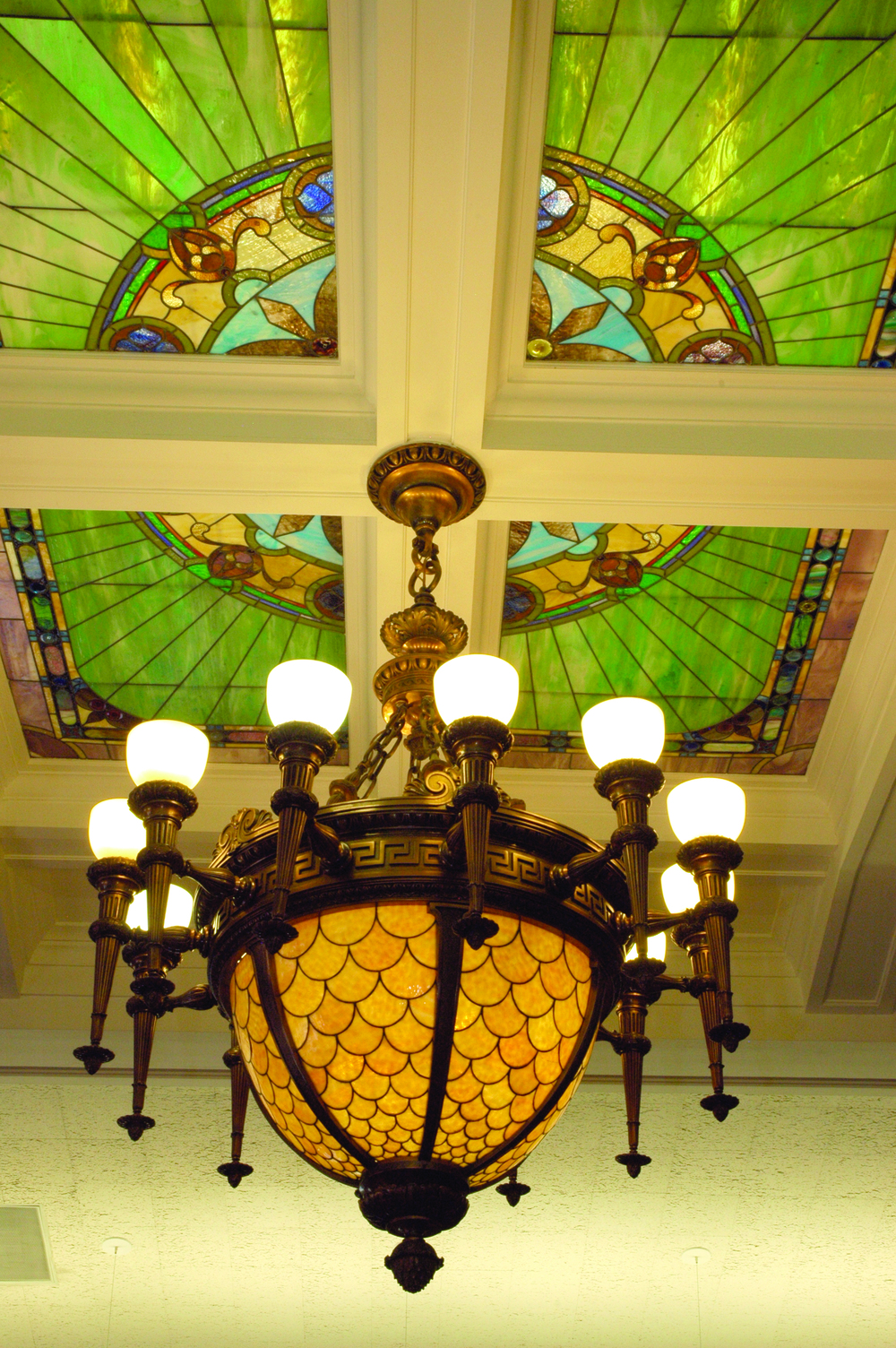 The Supreme Court chandelier in Room 302 is one of the oldest and most elaborate chandeliers in the Capitol and hung beneath the stained glass lay-light in the middle of the hearing room.
