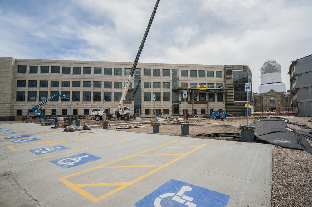 For Herschler East, state employees can use the State Parking Structure located at 25th Street and Carey Avenue or the State parking lot at 25th Street and Pioneer Avenue. Visitors can park on the third level of the structure or at the parking lot. To accommodate ADA parking, a temporary lot has been constructed on the north side of Herschler East on West 26th Street.