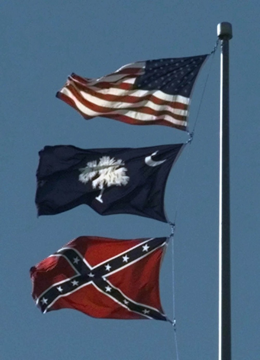 "The Confederacy was disbanded over 100 years ago when it lost ""The War of Northern Aggression"" as some southerners still like to call it.  So if the Confederacy was disbanded, so should the flag be.  This is the United States of America."