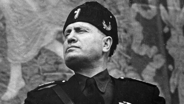 Benito Mussolini, a dictator not a leader.  Leaders don't need to rule with an iron fist or oppress through facist rhetoric of beliefs.