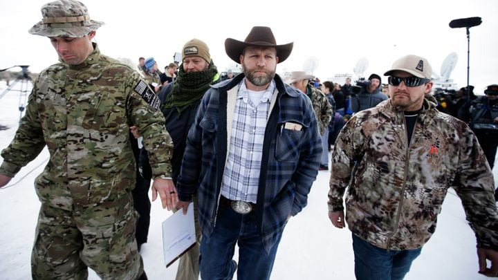 The  Bundy Militia .  They perform an illegal armed occupation of a government building and land and what do they get?  Not a bullet or removed, just negotiations and more press.