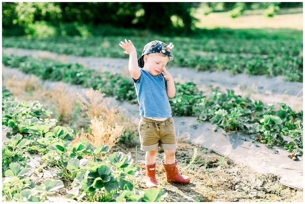 Strawberry picking is hard. He was ready to call it a day. :)