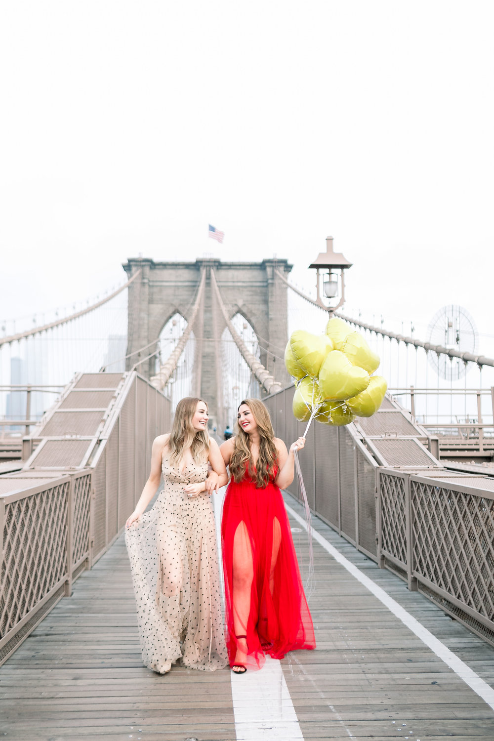 Collins Tuohy Smith and Megan Bonner on Brooklyn Bridge New York City by Mary Kate Steele Photography