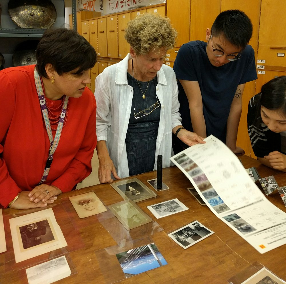 Workshop participants identifying unknown photographs at The Royal Ontario Museum. (Photo: Jennifer Orpana, 13 Sept. 2016)