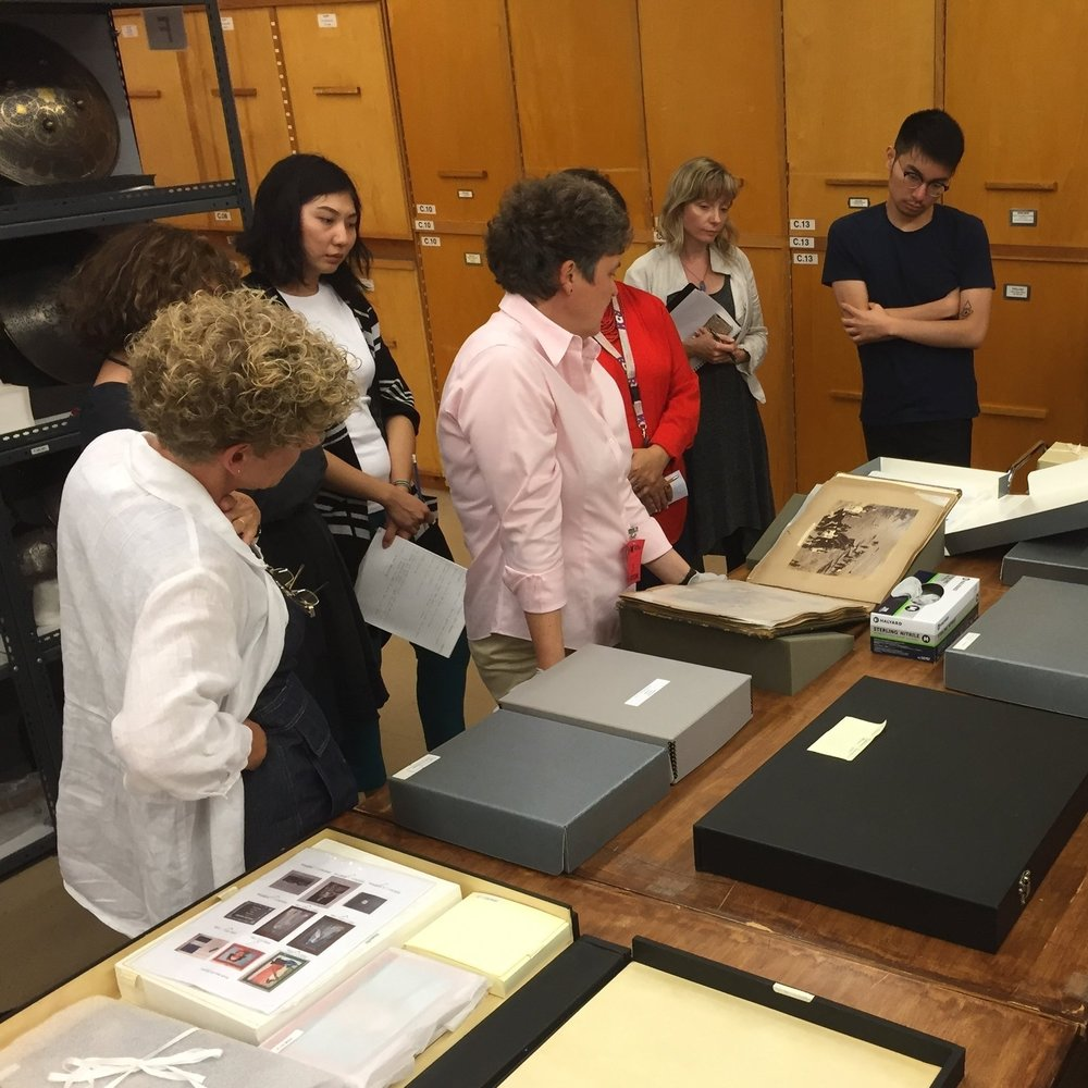 Ms. Fischer examines the album of the visit of the Duke of Connaught to Hyderabad from the ROM collection. (Photo: Celio Barreto, 13 Sept. 2016)