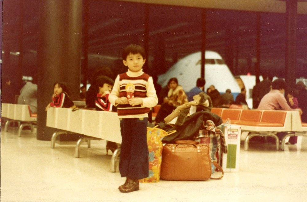 Hon with the family's luggage in the Narita International Airport during a stop-over on the way to Canada, Photographed by Luong Thai Lu, March 1979, Narita, Japan. Courtesy of the Lu-Thai family