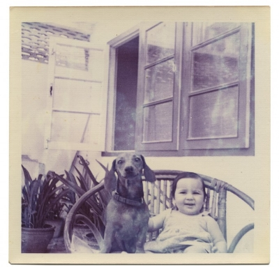 Anil Dewan, Deepali with her dog on a wicker garden chair, New Delhi, India, 1972. Dye coupler print, 3.4 x 3.4 in. Courtesy of Deepali Dewan.