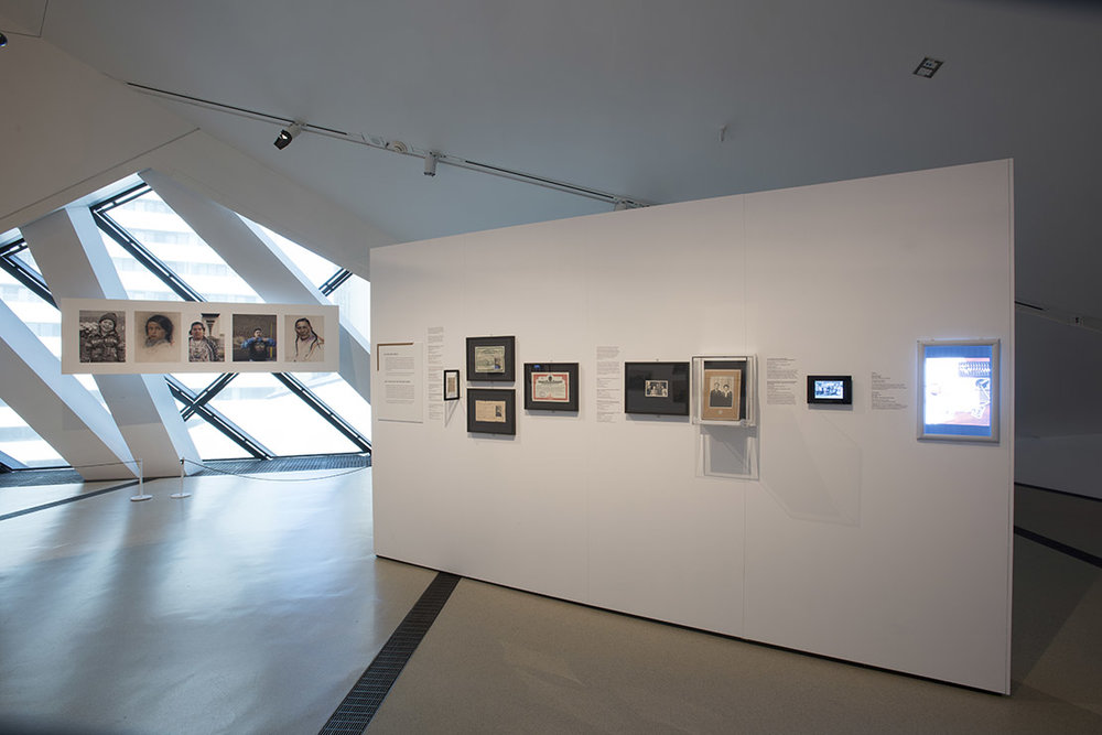 The Family Camera, installation view showing Happy Father's Day (2015) by Jeff Thomas and the State of Family section (Photo: Brian Boyle MPA, FPPO photo, 2017 © ROM)