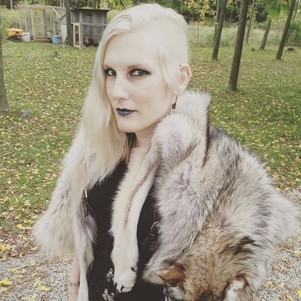 Photo of Jade at the Vindisir Kindred Winterfinding blót gathering taken by one of their kindred. Ridgetown Ontario. October 2017. Courtesy of Jade Pichette and the Canadian Lesbian and gay archives.