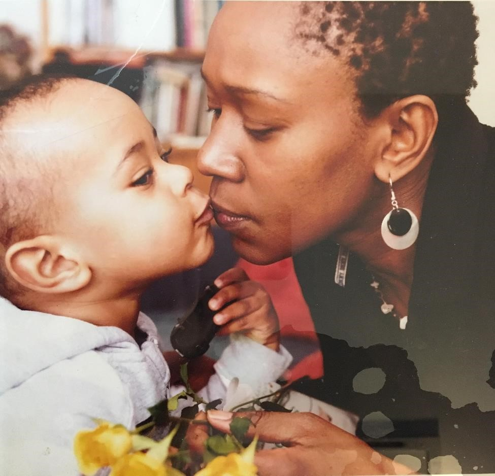 Teo kissing her son, matthew. Unknown photographer. 2008. digital image of a dye coupler print behind glass. Gift of Teo owang. Courtesy of the family camera network and the Canadian lesbian and gay archives.