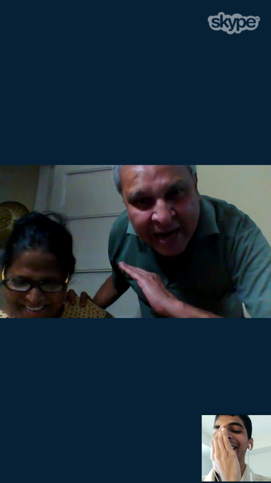 Skype conversation between Mudit Ganguly and his parents, Mali and Alin. Screenshot by Mudit Ganguly. 2017. Toronto, Ontario; Mumbai, India. Digital image. Gift of Mudit Ganguly.   Courtesy of The Family Camera Network and the Canadian Lesbian and Gay Archives.