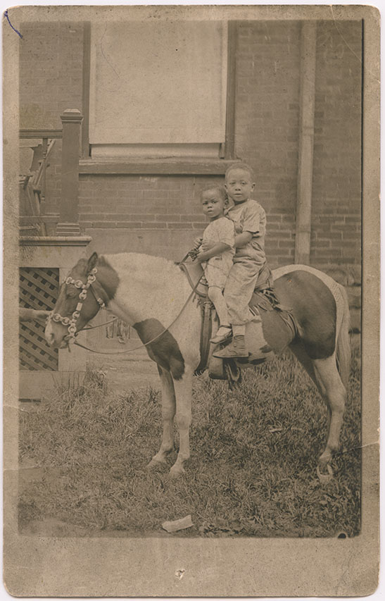 Norman H. Lee (Diddy) and Frank Newton Lee Jr. (Newtie), on a pony near St. Patrick Street. Around 1920. Unknown Photographer. Toronto, Ontario. Gelatin silver print. Gift of Nancy M. Lee. Courtesy of The Family Camera Network and the Royal Ontario Museum. 2018.31.2. (Photo: 2017 © ROM)