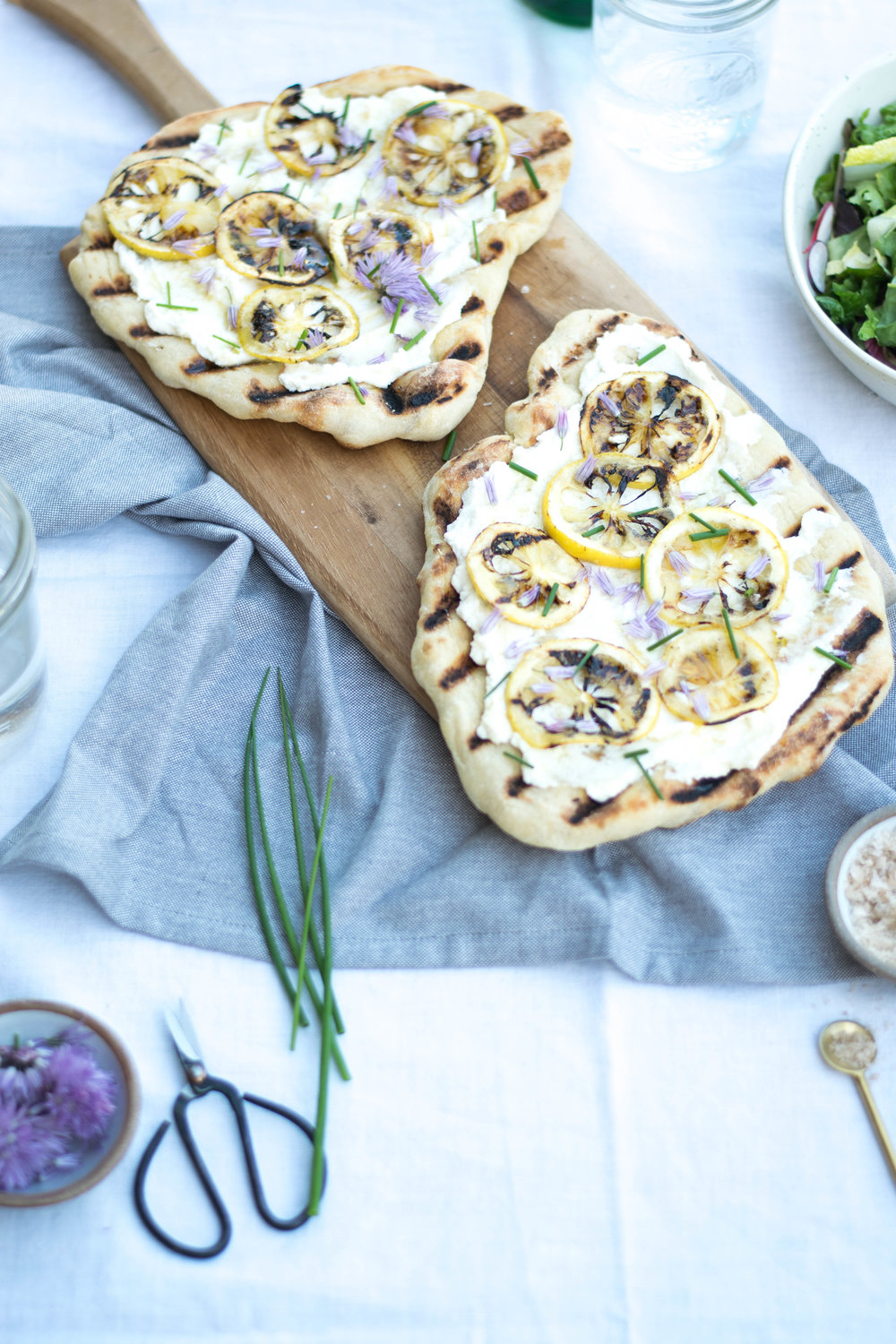 Grilled Flatbreads with Charred Lemon, Ricotta, + Chive Blossoms | All Purpose Flour Child