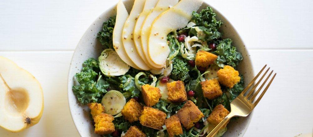 Harvest Kale Salad with Pears & Pumpkin Cornbread Croutons