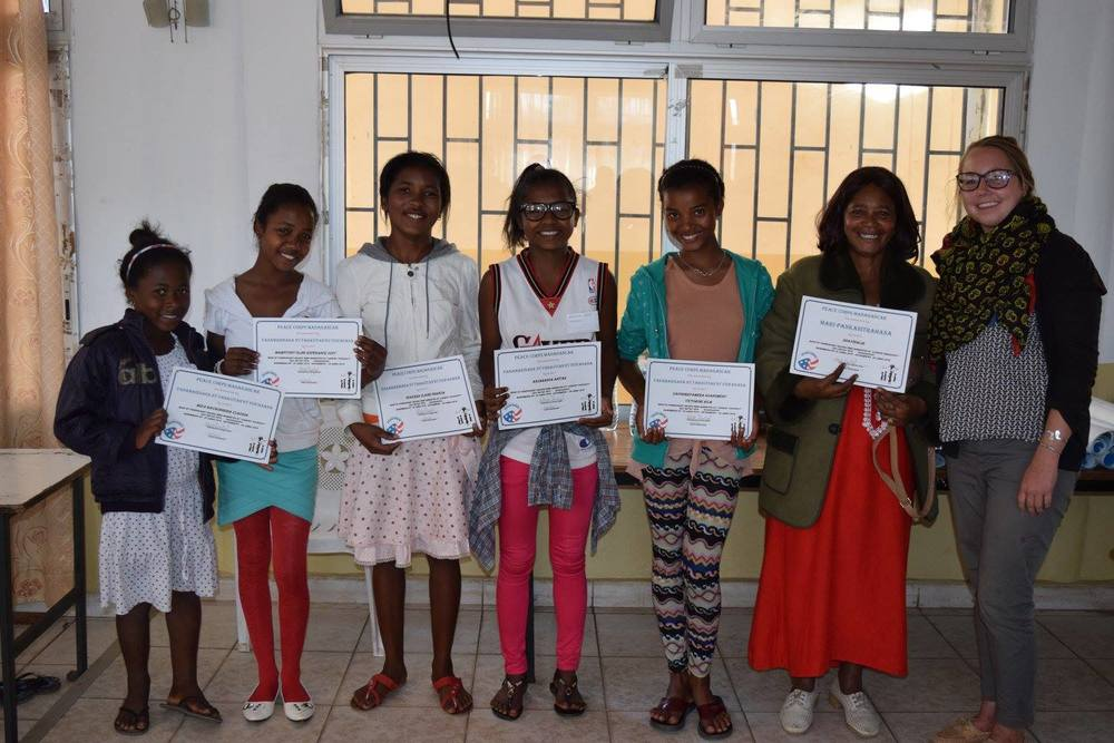 Claudia, Oline, Francia, Anitah, Victorine and Soavinalie, our community chaperone with their certificates at the closing ceremony.
