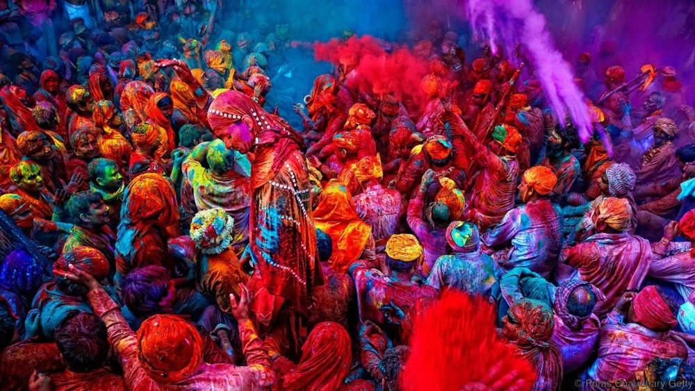 India's holy festival of colors - Celebrate the end of winter at Holi, an exhilarating Hindu festival that welcomes in spring through the throwing of vibrantly coloured powder. //  BBC Travel