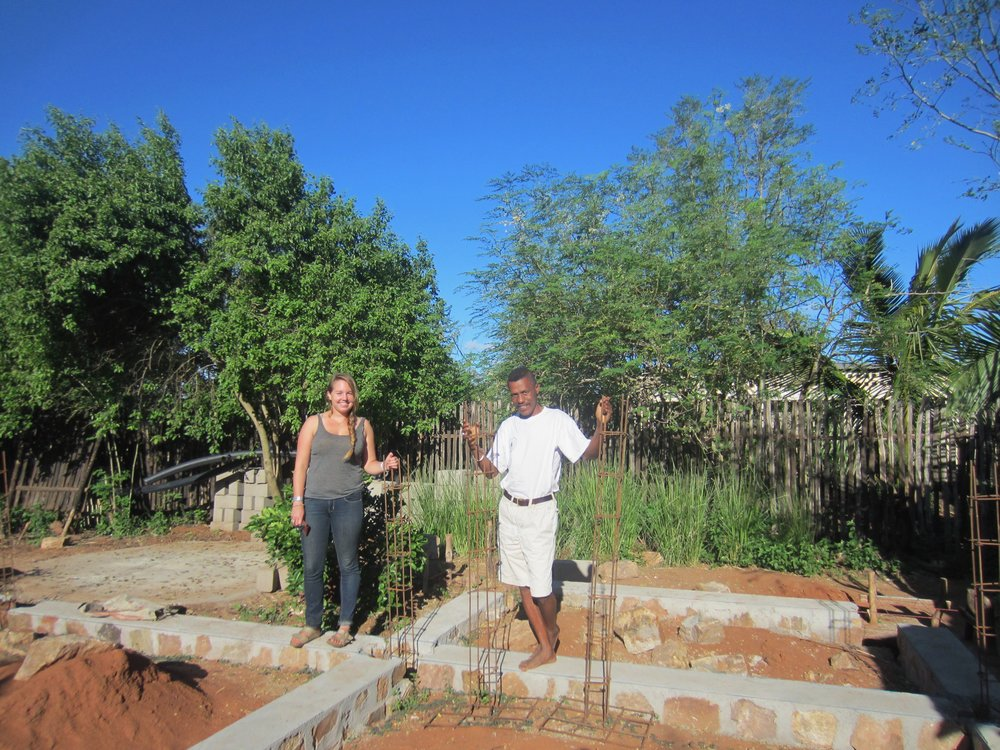Josoah and I worked together with the community to build a community library. Here we are standing on its foundation back in May 2017. It is now complete and adults and children of all ages attend English club and read books inside.