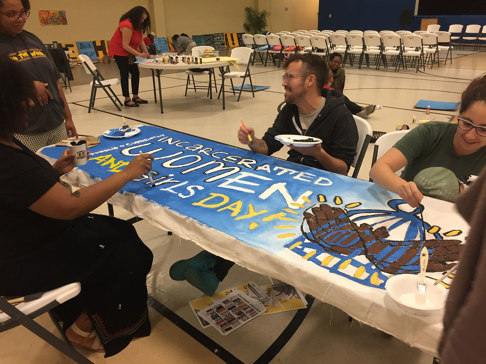 formerly-currently-incarcerated-women-girls-day-banner-painting.jpg