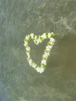 flower lei in the shape of heart floating on water