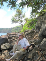 Hawaii voluntourist takes a break from trail clearing.