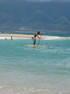 Stand up paddle long board surfing on Maui Hawaii