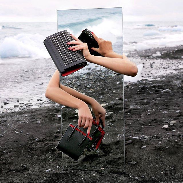from @louboutinworld -  Traveling light. New Paloma Ultra Black boasts a slim silhouette and new lightweight construction.📸@guillaumefandel - #iceland #on_location #mirror #vik #diamondbeach  Special thanks to @ylvafalk and @sophie_lemedioni ✊👌✊