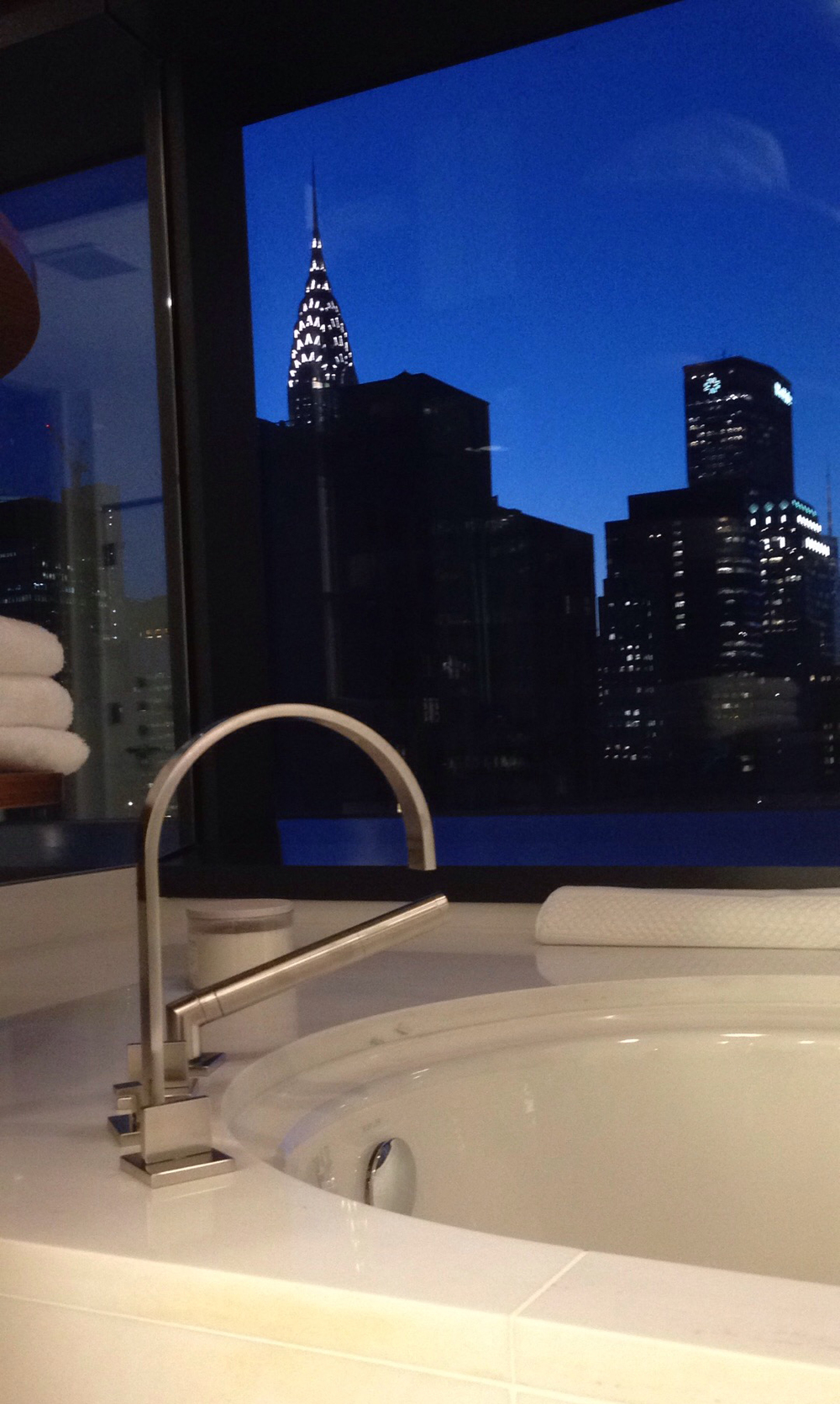 Enjoy your bath with the ultimate view of the Chrysler Building on the horizon