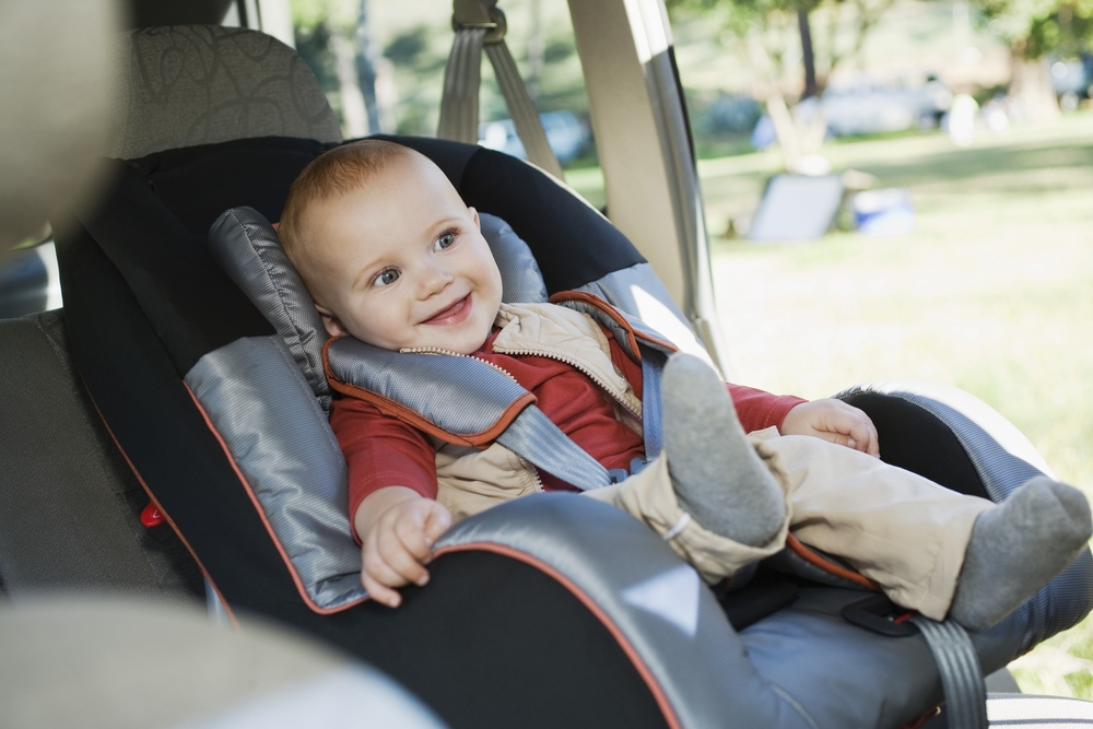 Cute baby in car seat
