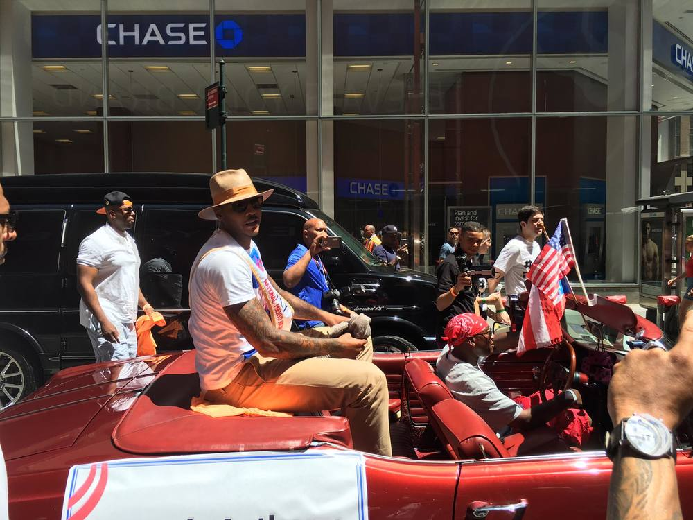 NBA Superstar Carmello Anthony, riding in a fantastic 1968 red Buick Skylark convertible, driven by owner Lovell Mason.