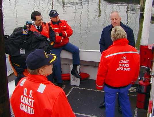 News 12 films while USCG Capt. Croce, Ossining Police Chief Donato and Lou Liotti (USCG Aux) look on