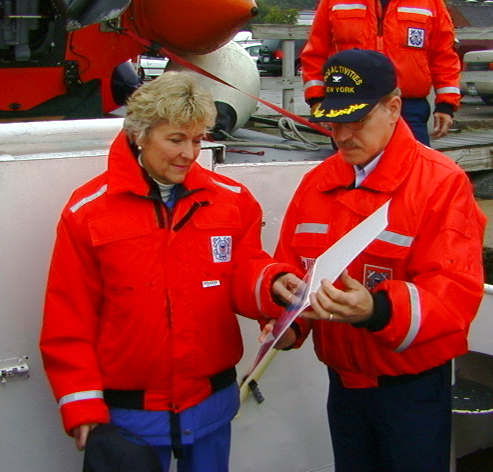 USCG Captain Daniel R. Croce presents a 9/11 photograph to Congresswoman Sue Kelly aboard Launch 5