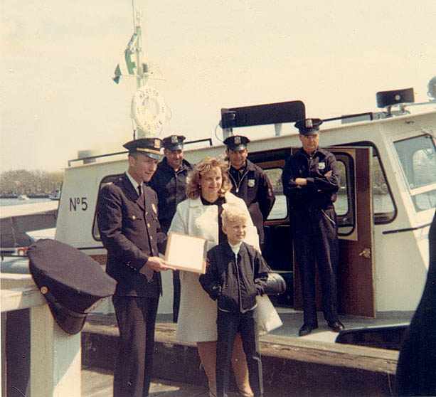 Henry's wife and Henry Jr. standing in front of Launch 5 with the dedication plaque