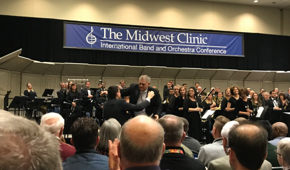 Tyler and Professor Randall Coleman after the Alabama Winds performance of ' Best of Rooms ' at Midwest Clinic.