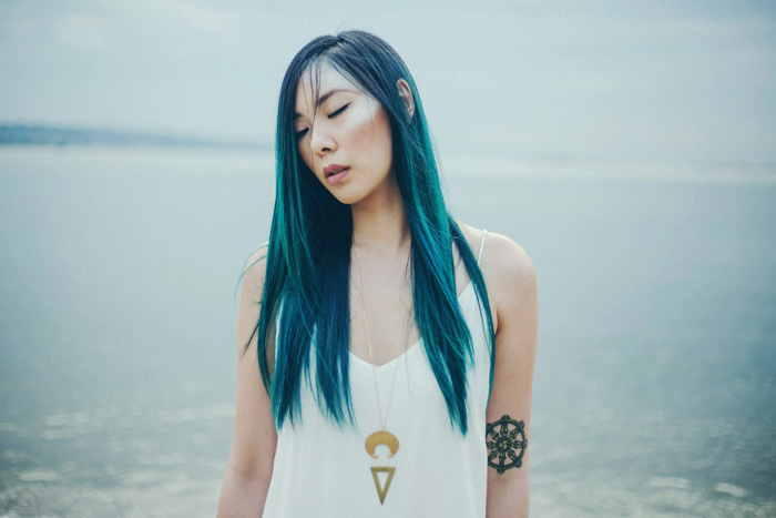 Cin Wu photographed by  Sarah England Photography  wearing the  Compass Necklace .  MUAH by Cin Wu.